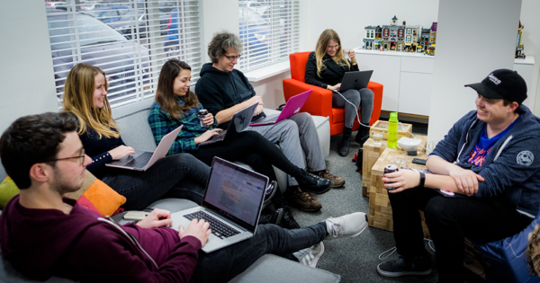 A few people of team Yoast sitting and working together