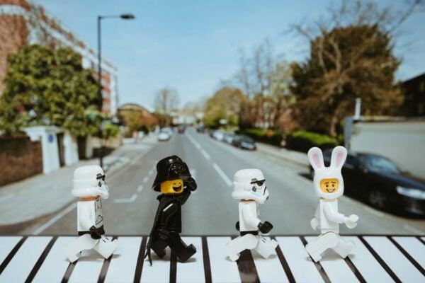 photo of four LEGO dolls walking across abbey road