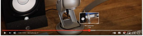 Imagen que muestra indicadores de marca de tiempo en la barra de reproducción de un video de YouTube